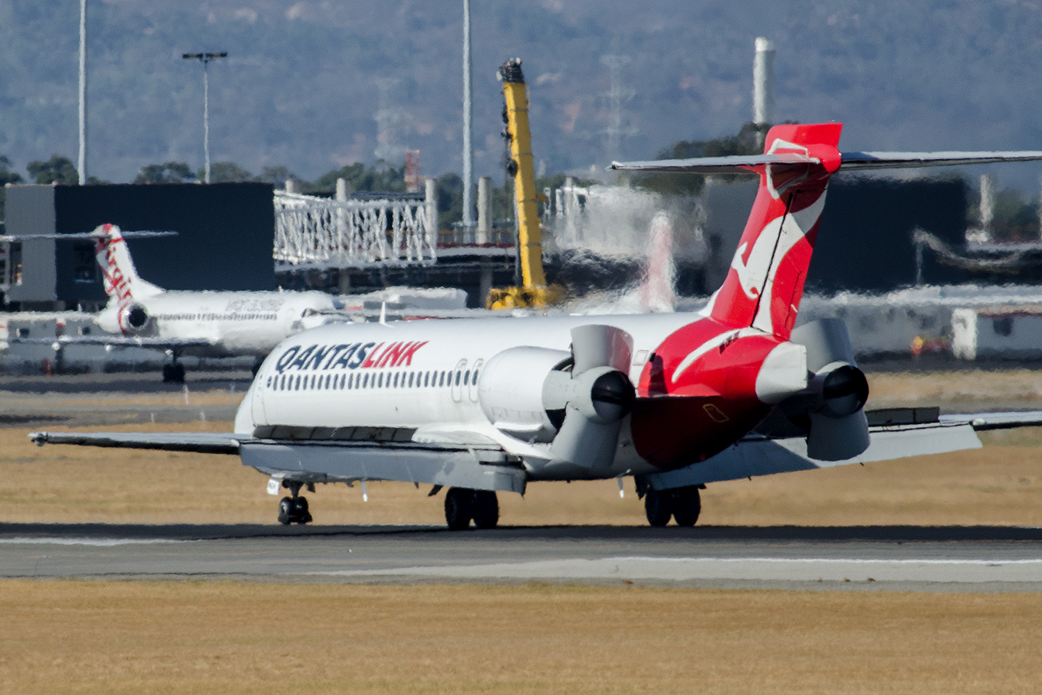 Another 717, VH-NXH, showing off it's reverse thrust profile.