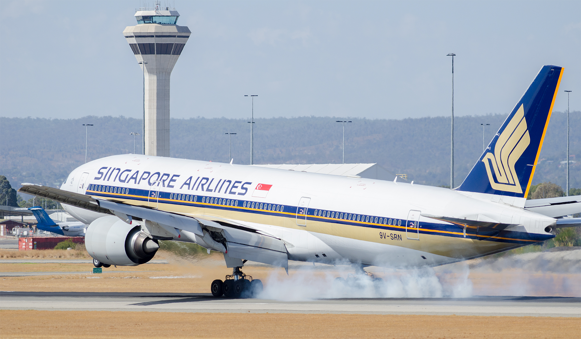 Where there's smoke, there's a 777 grabbing onto the earth with all 12 tires...