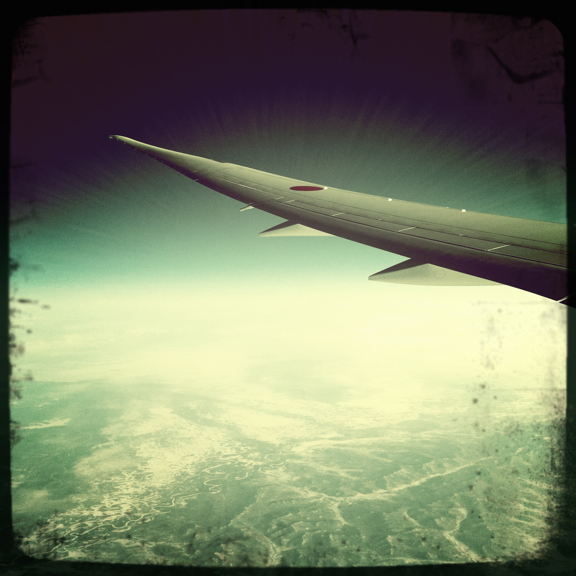 A Hipstamatic impression of 'Morning over Russia'...holy crap, that's Russia down there!